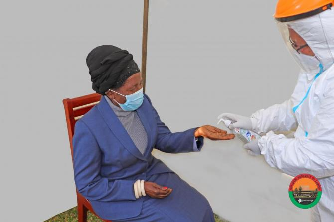 Her Honour the Vice President, Madam Inonge Wina, MP, being sanitized after the Covid-19 Swab at Parliament Buildings